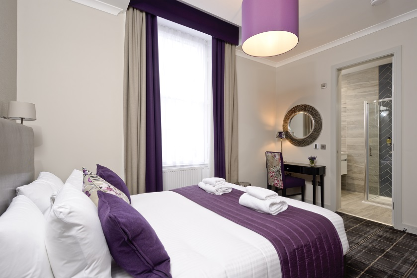 Stylish bedroom at Charlotte Square Apartments - Citybase Apartments