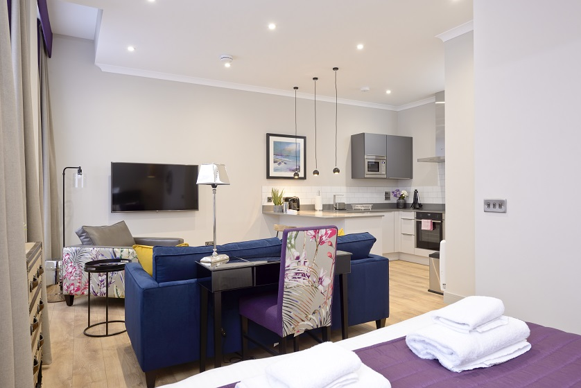Contemporary living area at Charlotte Square Apartments - Citybase Apartments