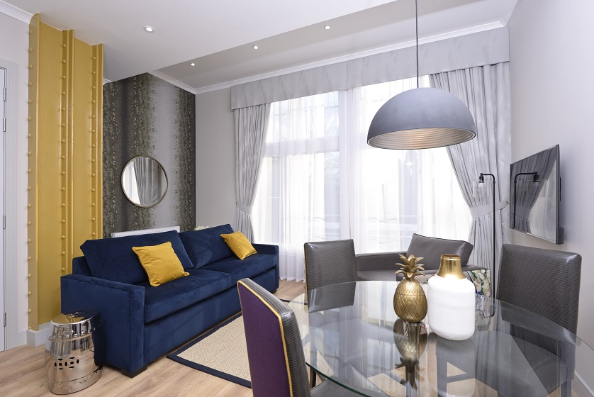 Stylish living room at Charlotte Square Apartments - Citybase Apartments