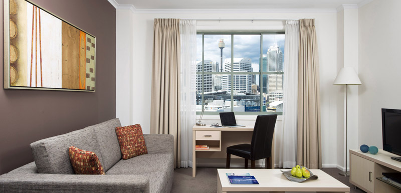 Living room at Oaks Sydney Goldsbrough Suites - Citybase Apartments