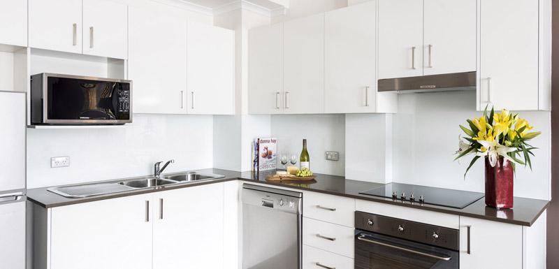 Kitchen at Oaks Sydney Goldsbrough Suites - Citybase Apartments