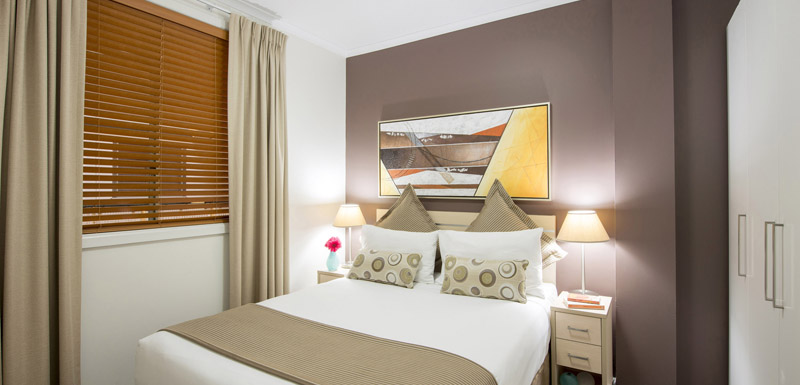 Bedroom at Oaks Sydney Goldsbrough Suites - Citybase Apartments