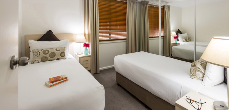 Twin beds at Oaks Goldsbrough Apartments - Citybase Apartments