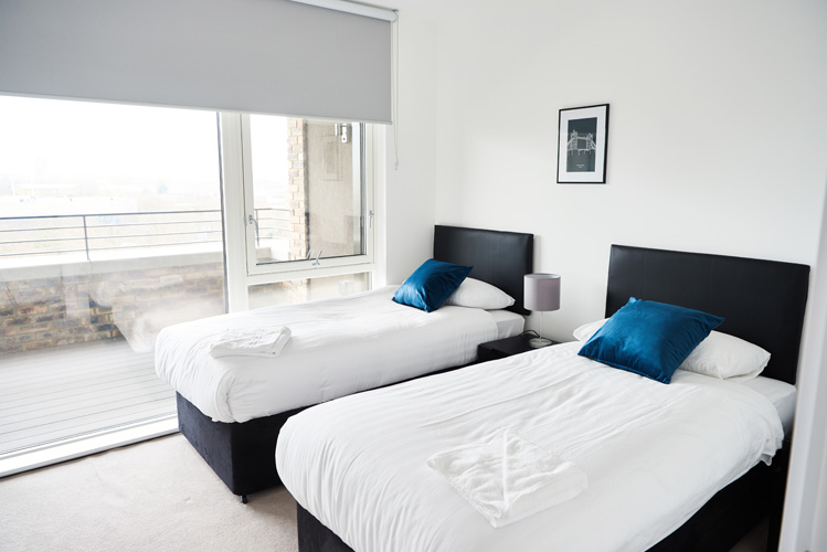 Spacious bedroom at Canada Water Apartments - Citybase Apartments