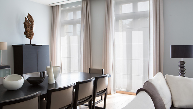 Modern dining area at La Reserve Paris Apartments - Citybase Apartments