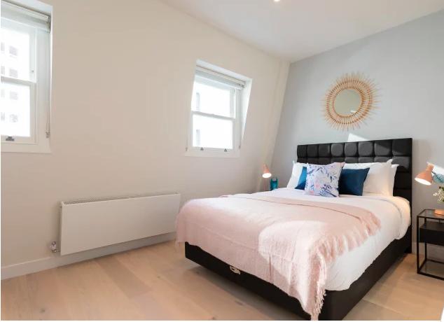 Large bedroom atKensington High Street Serviced Apartments - Citybase Apartments