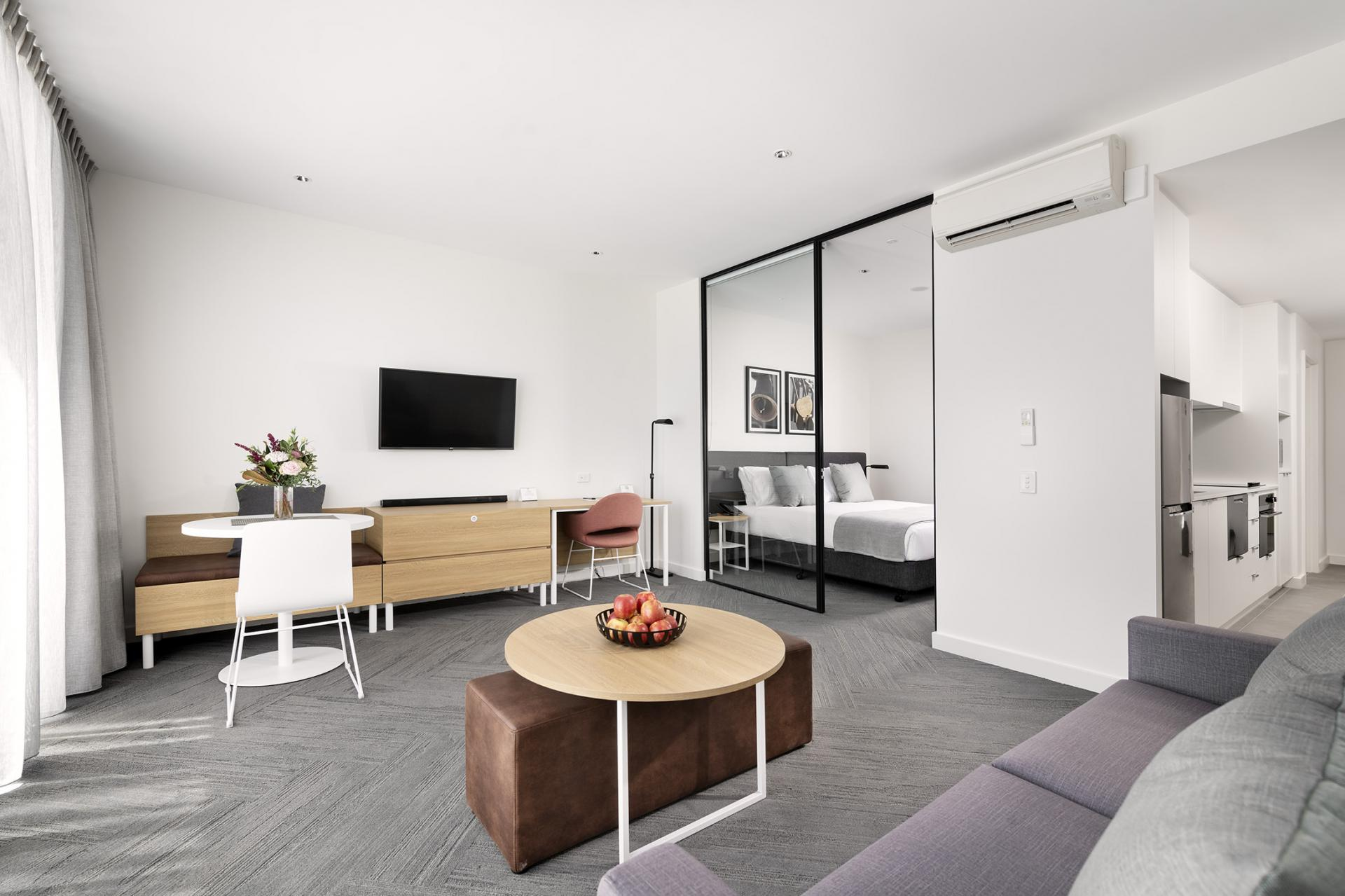 Living room at Quest South Perth Foreshore - Citybase Apartments