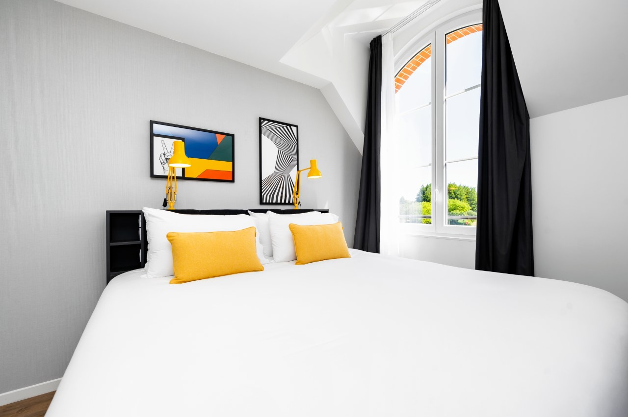 Yellow cushions at Marne La Vallee Aparthotel, Centre, Bailly-Romainvilliers - Citybase Apartments