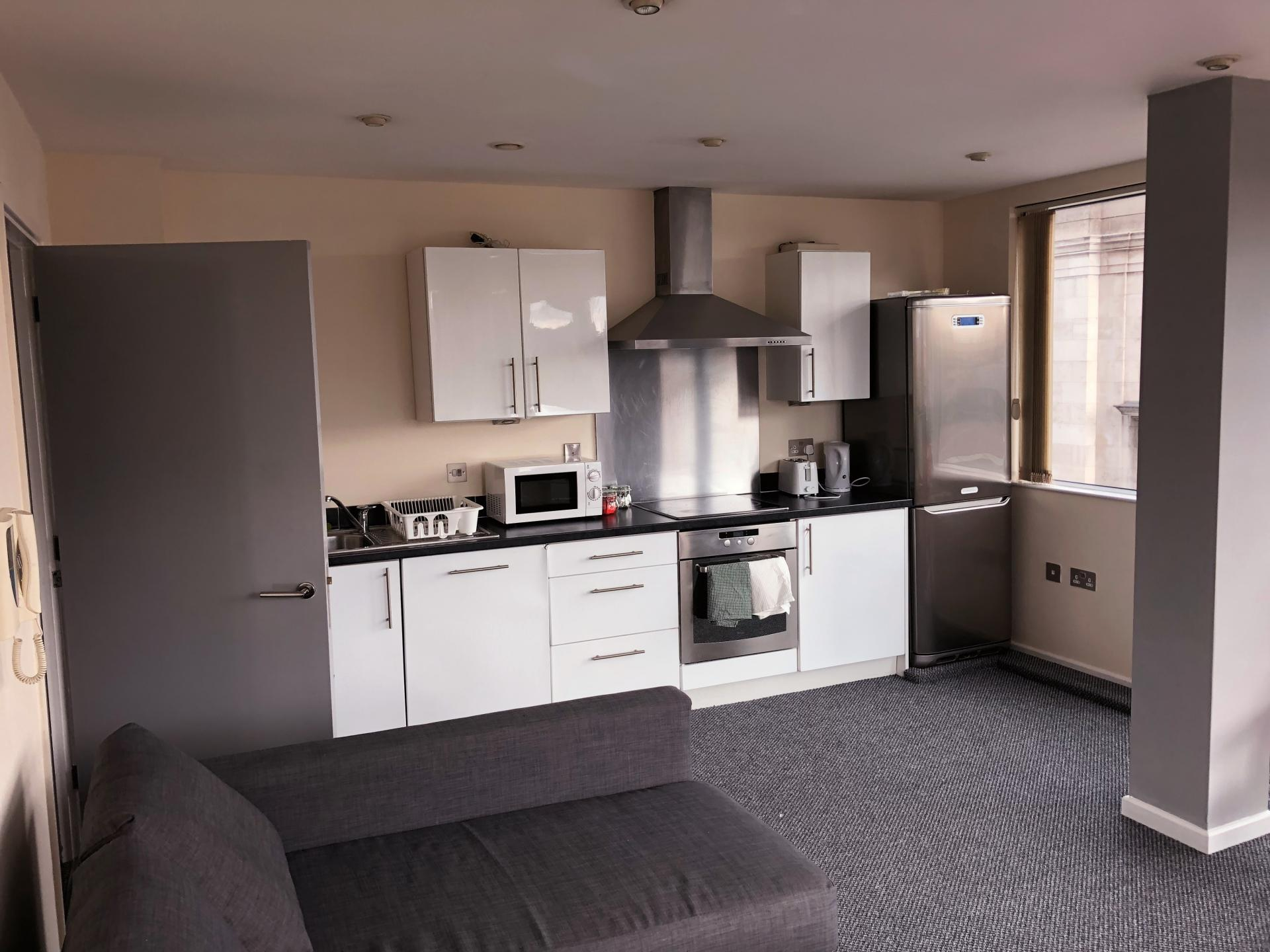 Open-plan living area at Broughton House Apartments - Citybase Apartments