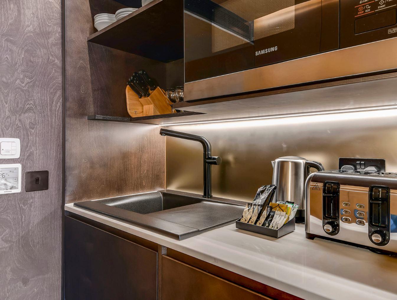 Kitchen facilities at Stow-Away Waterloo Apartments - Citybase Apartments