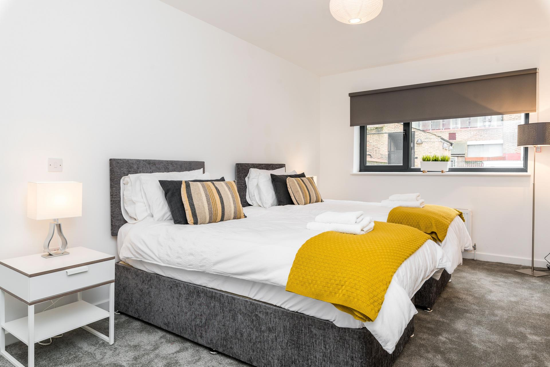 Twin beds at Vibrant Vauxhall Apartments - Citybase Apartments