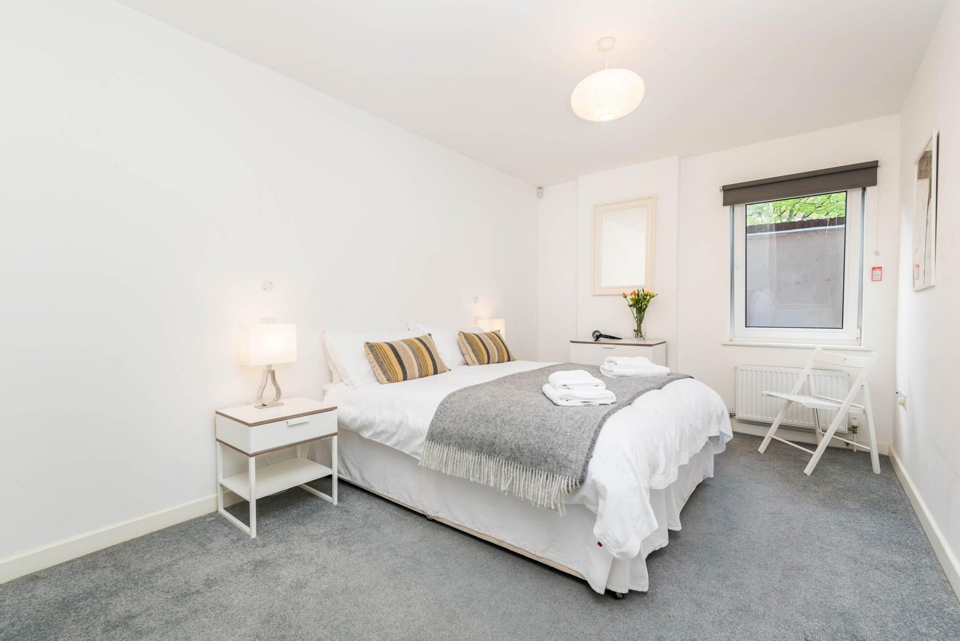 Spacious bedroom at Vibrant Vauxhall Apartments - Citybase Apartments