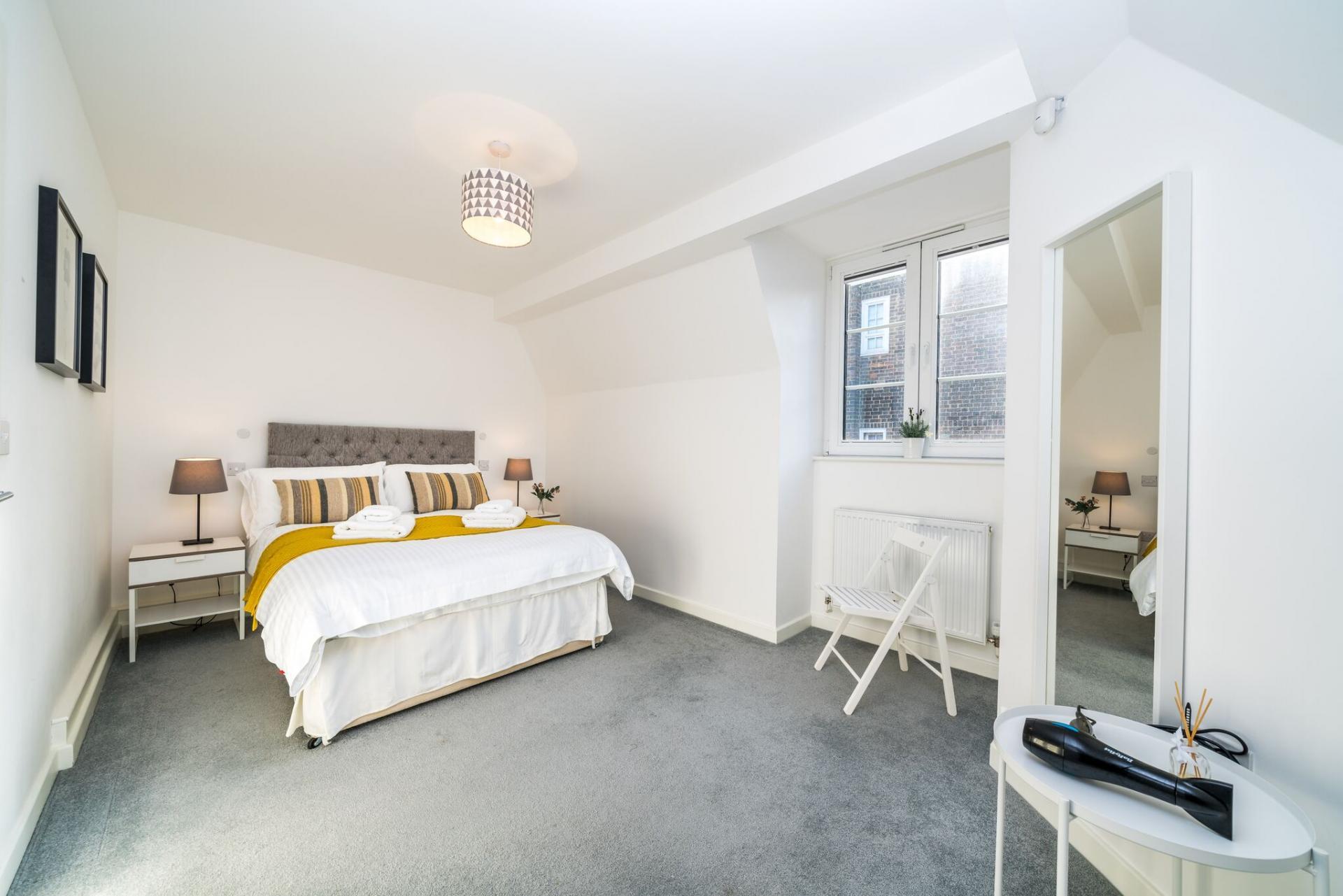 Stylish bedroom at Vibrant Vauxhall Apartments - Citybase Apartments