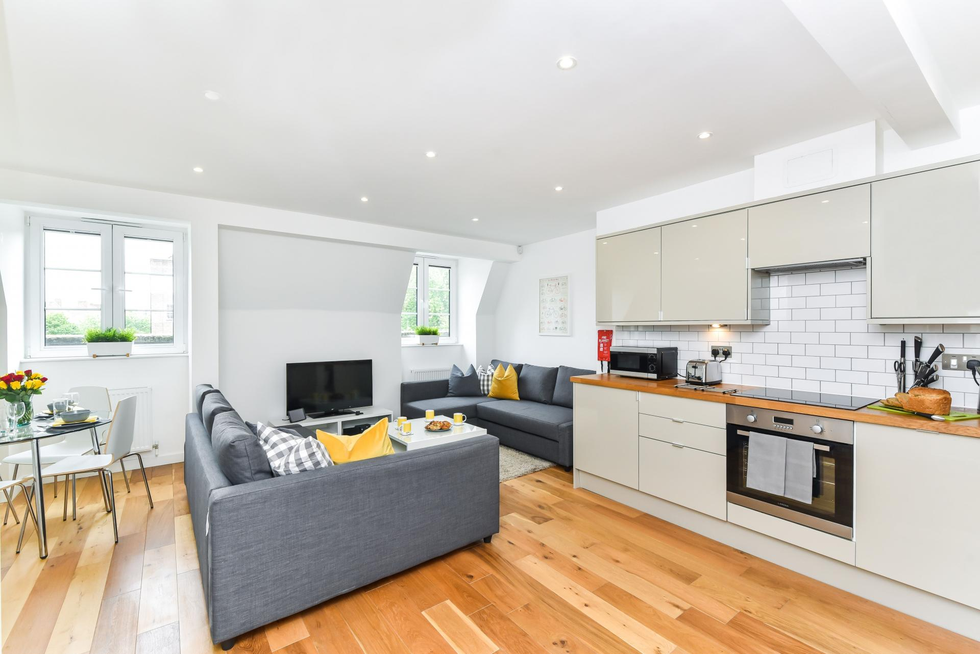 Open-plan living area at Vibrant Vauxhall Apartments - Citybase Apartments