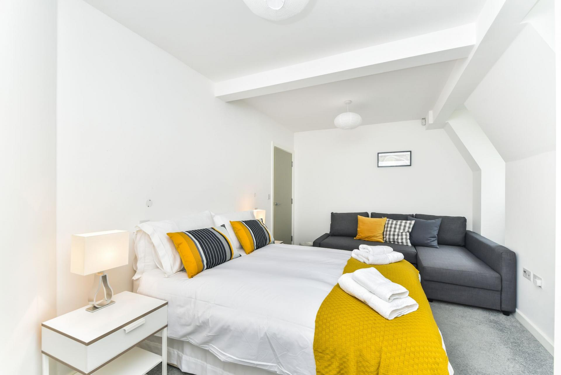 Cosy bedroom at Vibrant Vauxhall Apartments - Citybase Apartments