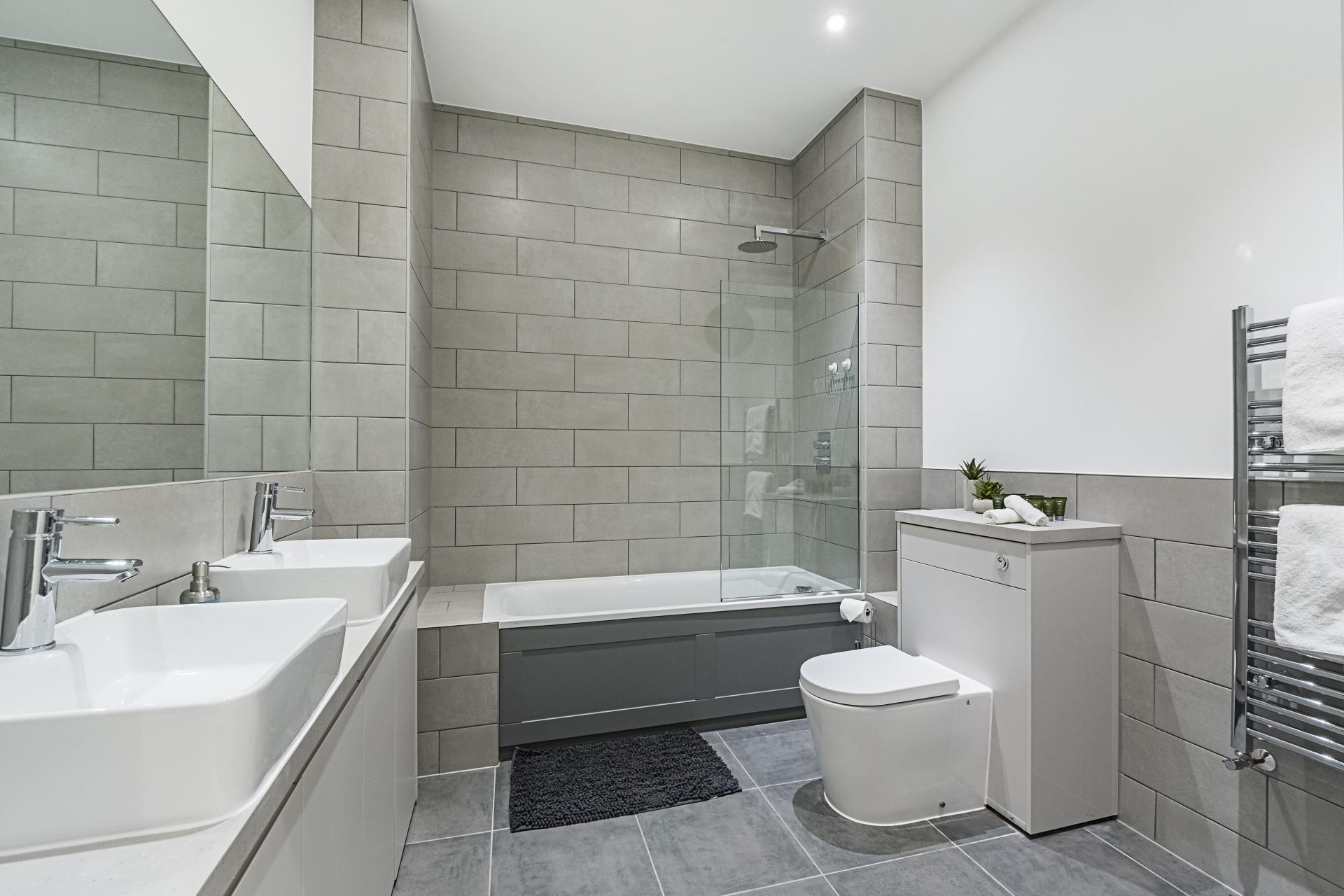 Large bathroom at Vibrant Vauxhall Apartments - Citybase Apartments