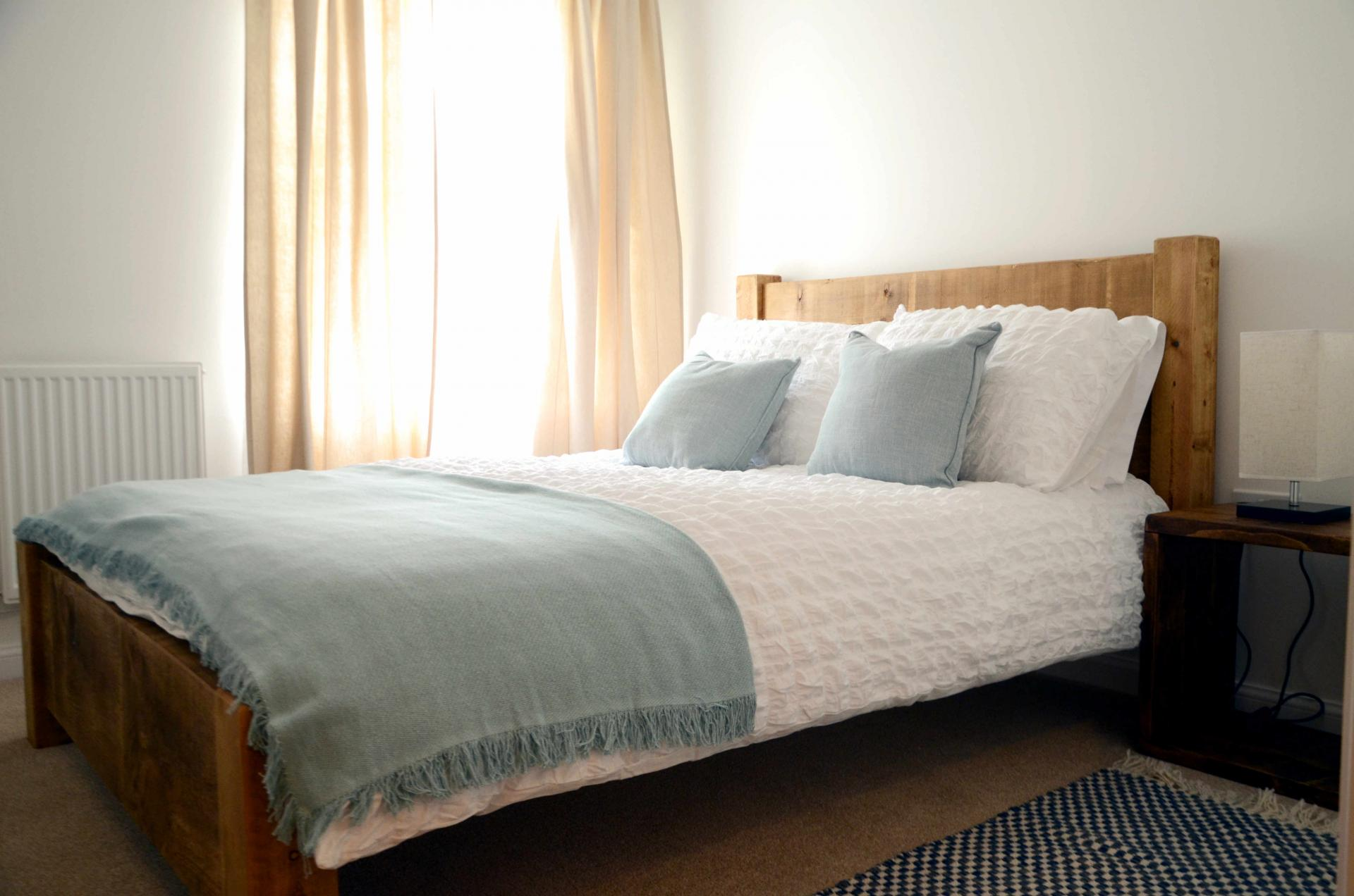 Double bed at Rosso Close Apartments - Citybase Apartments