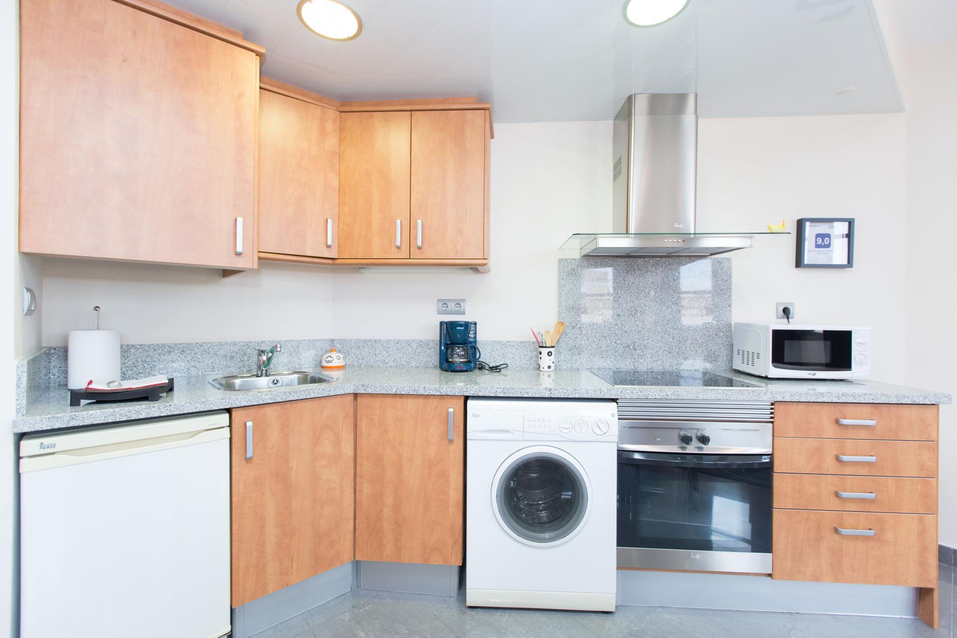 Laundry facilities  at Universidad Apartments - Citybase Apartments