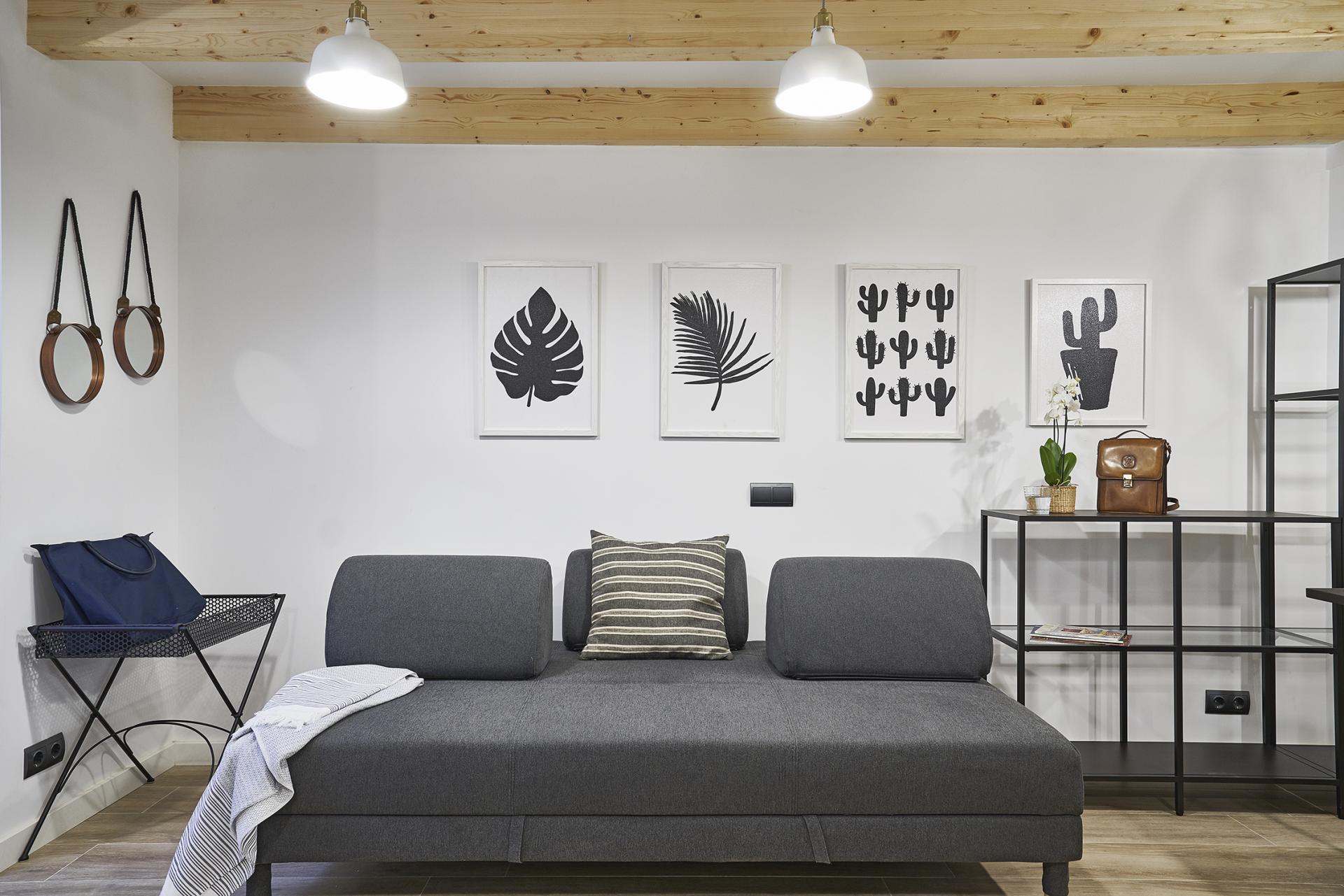 Sofa at Eixample Duplex Apartment - Citybase Apartments