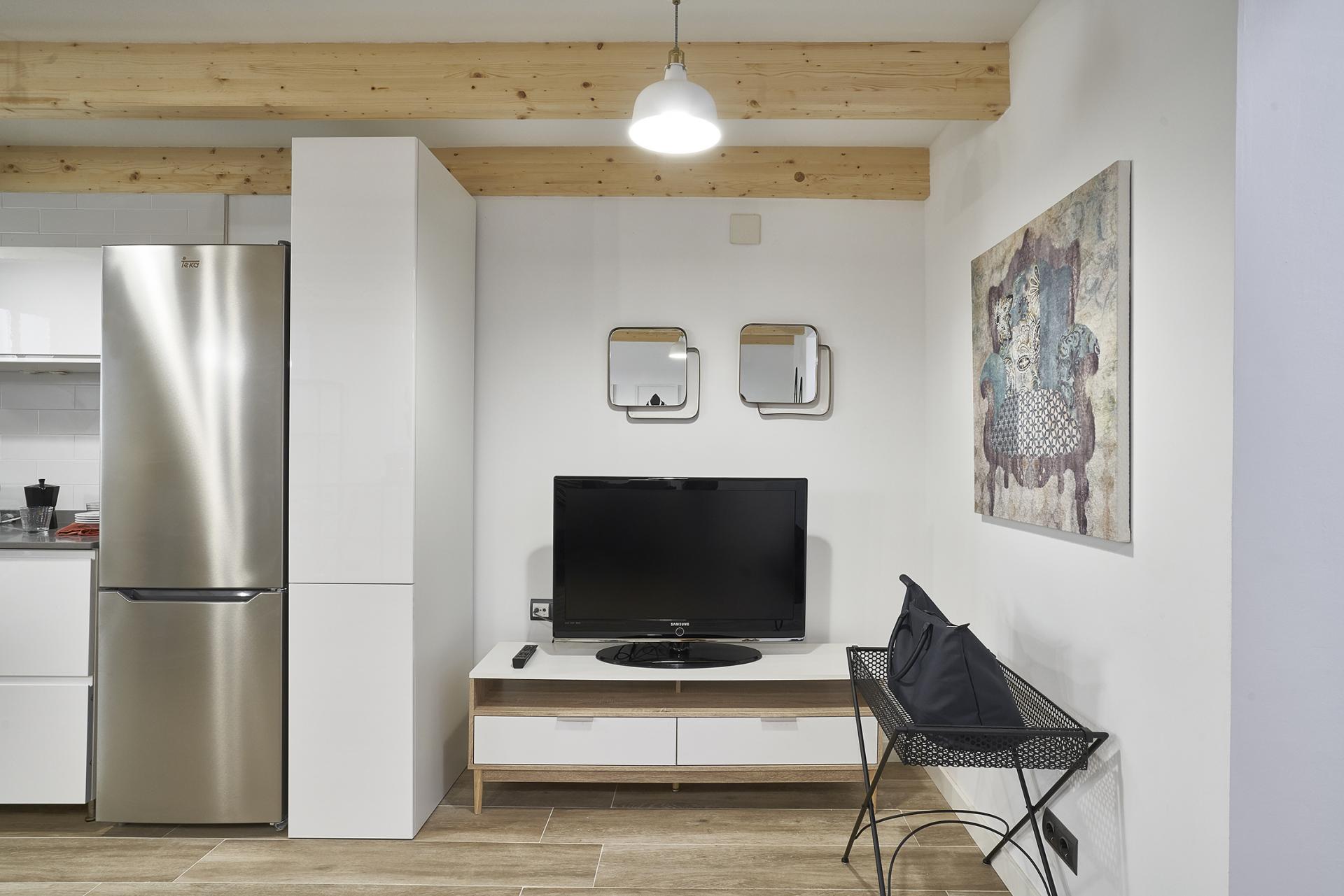 TV at Eixample Duplex Apartment - Citybase Apartments