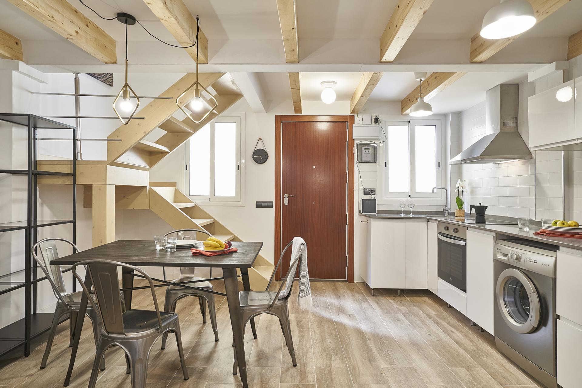Dining table at Eixample Duplex Apartment - Citybase Apartments