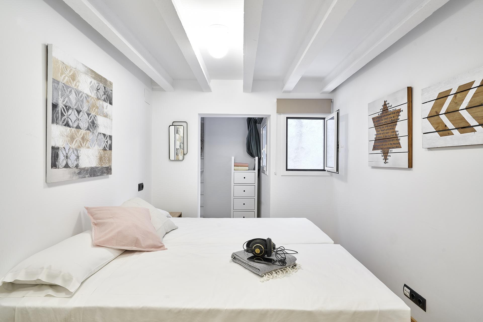 Bed at Eixample Duplex Apartment - Citybase Apartments
