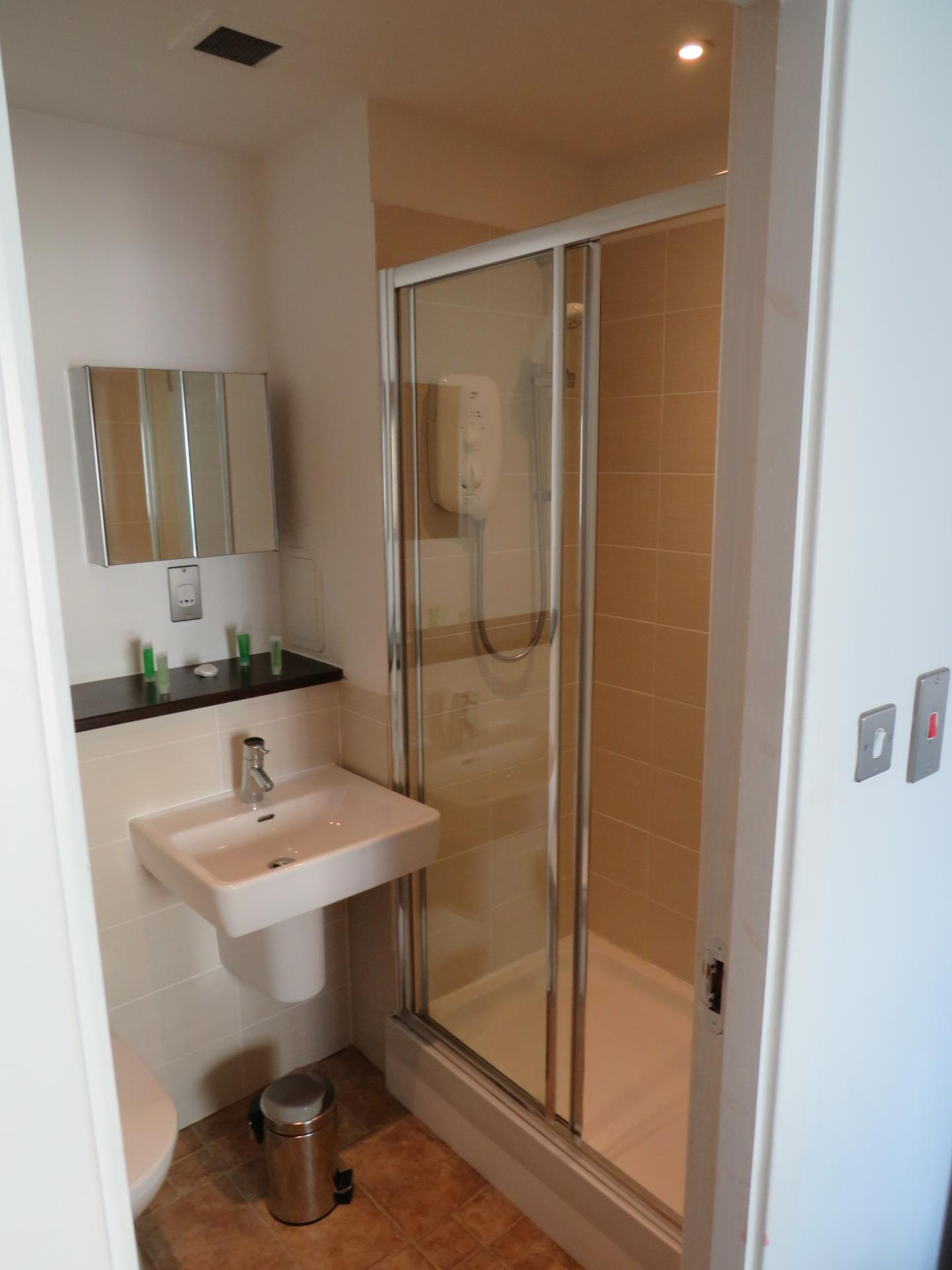 Shower at Oswald Street Serviced Apartments - Citybase Apartments