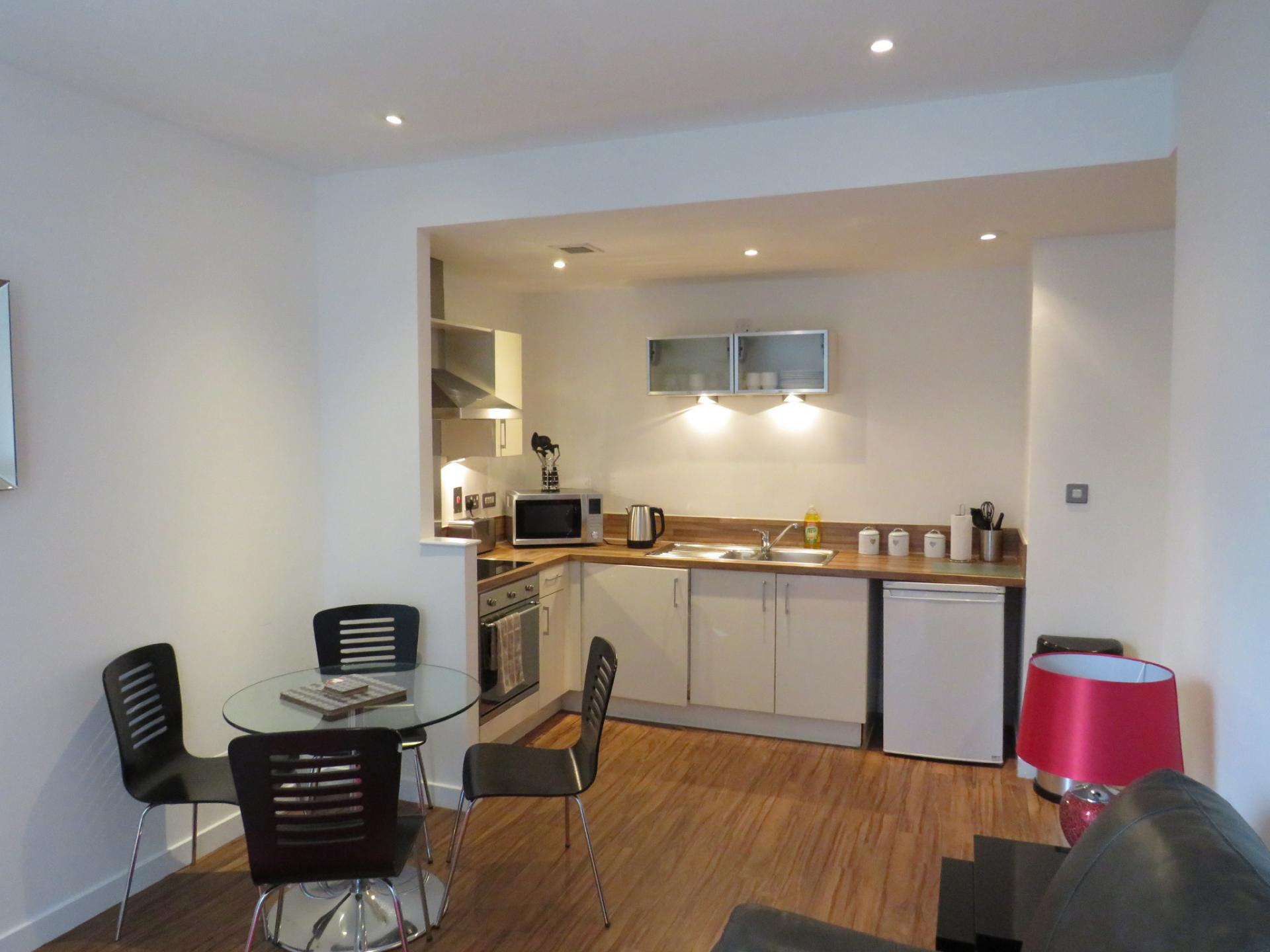 Open-plan kitchen area at Oswald Street Serviced Apartments - Citybase Apartments