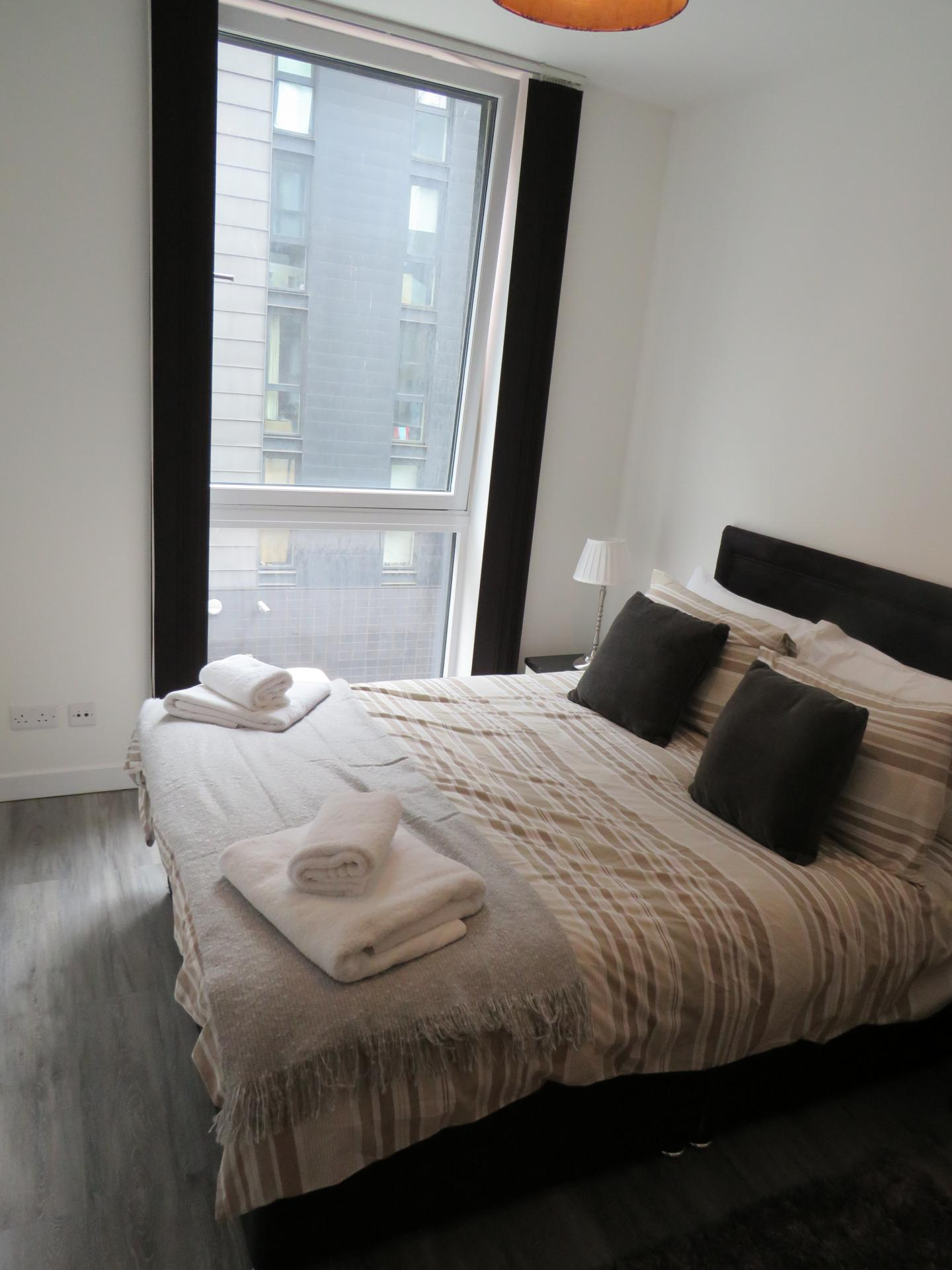 Double bed at Oswald Street Serviced Apartments - Citybase Apartments