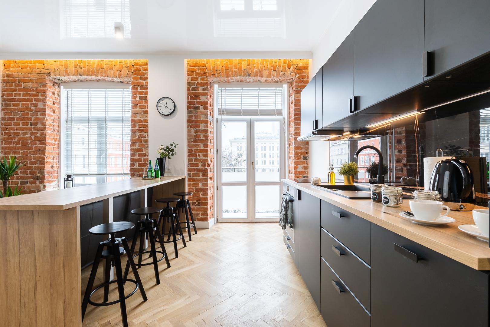 Kitchen space at Wspolna Apartments - Citybase Apartments