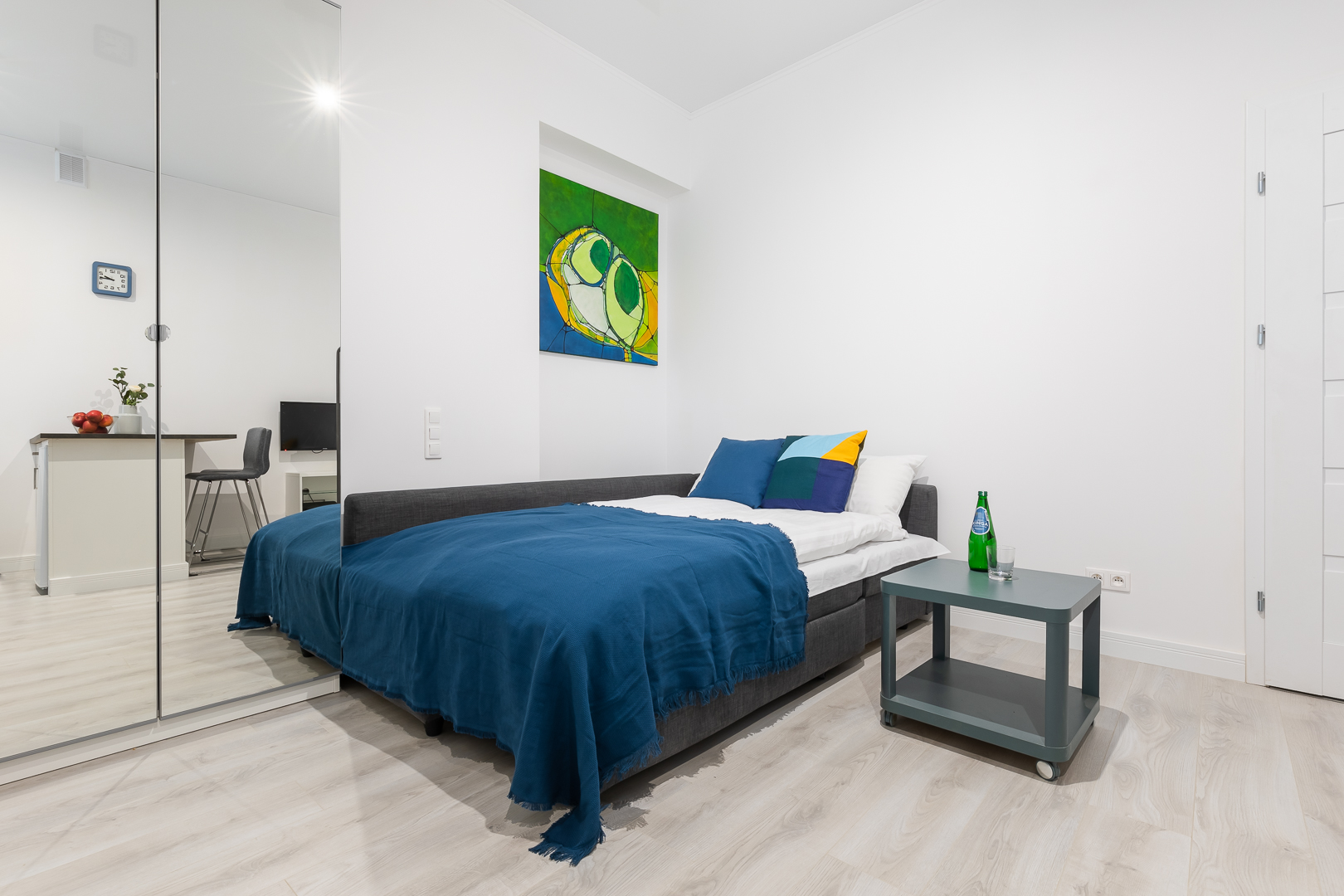 Blue bed at Wspolna Apartments - Citybase Apartments