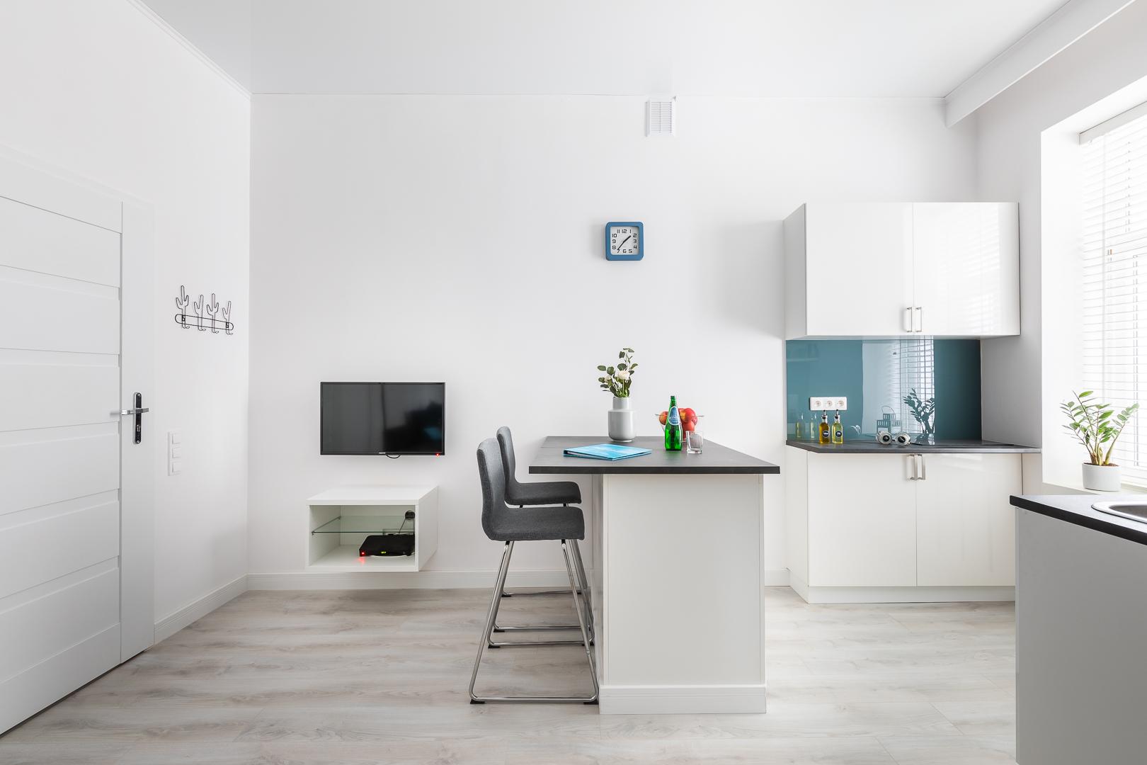 TV at Wspolna Apartments - Citybase Apartments