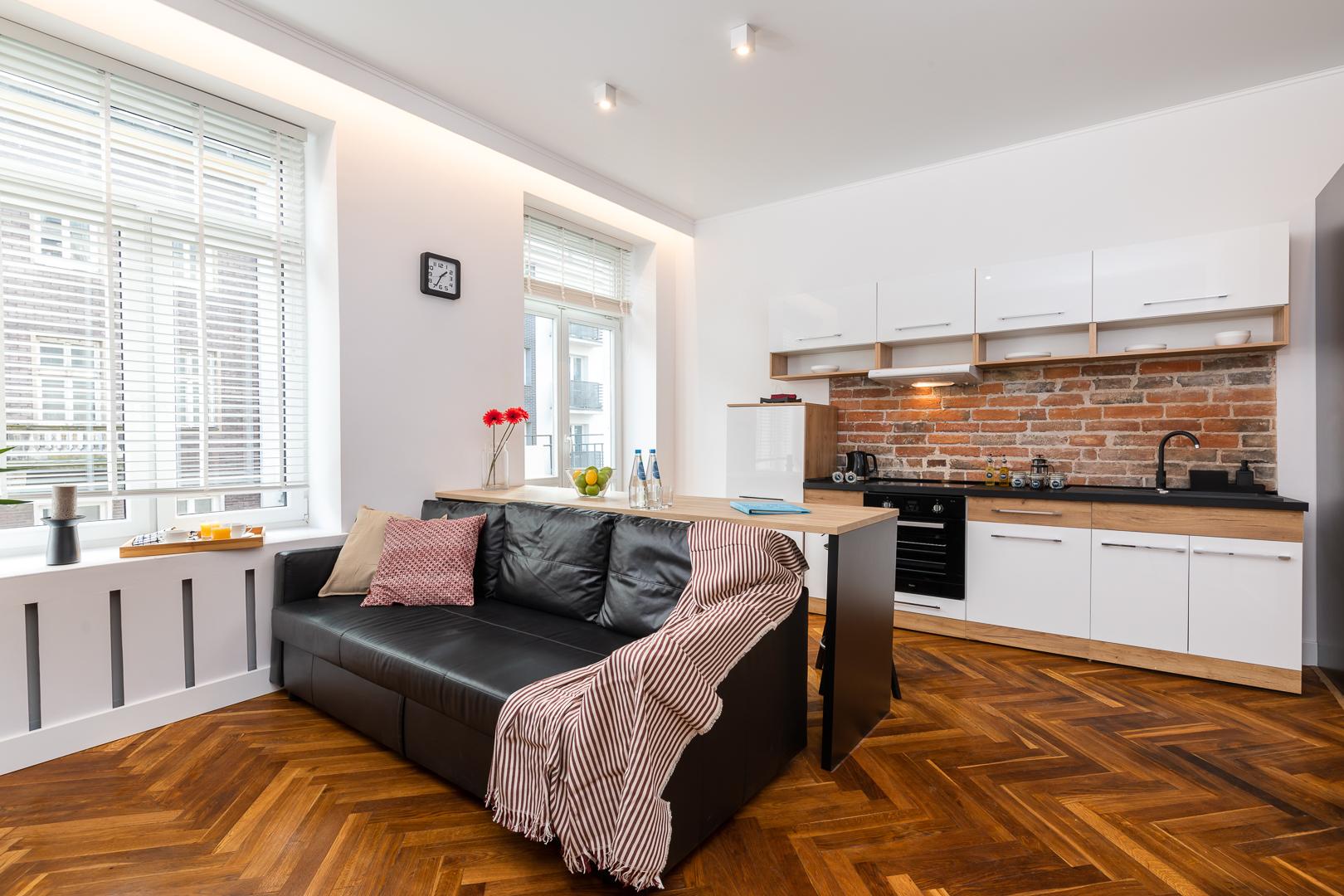 Sofa area at Wspolna Apartments - Citybase Apartments