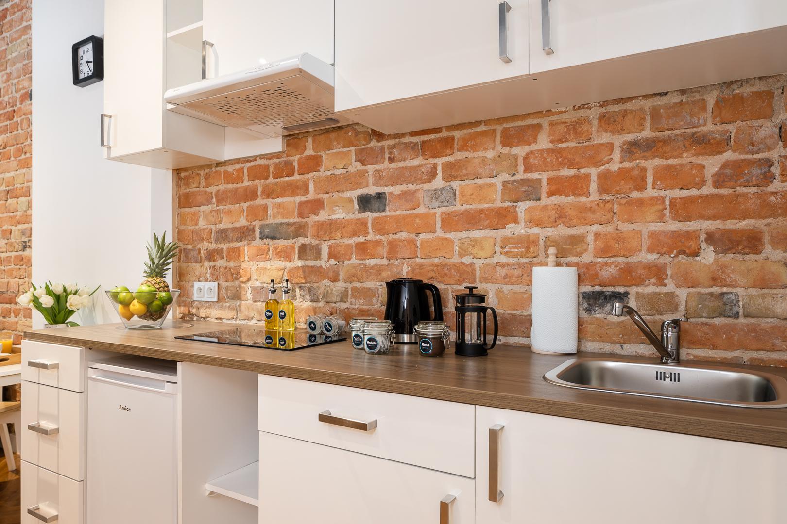 Basic kitchen at Wspolna Apartments - Citybase Apartments