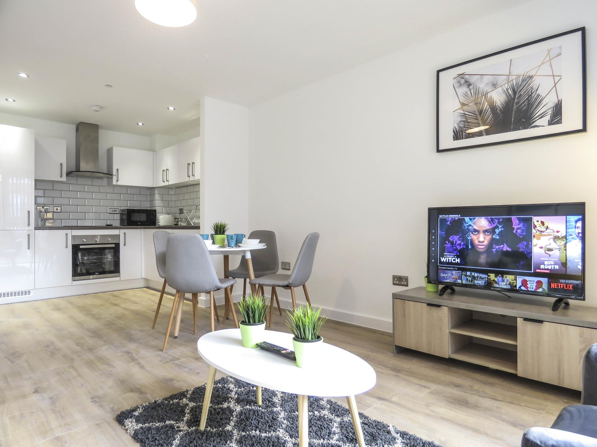 Open-plan living area at Canal Side Serviced Apartments - Citybase Apartments