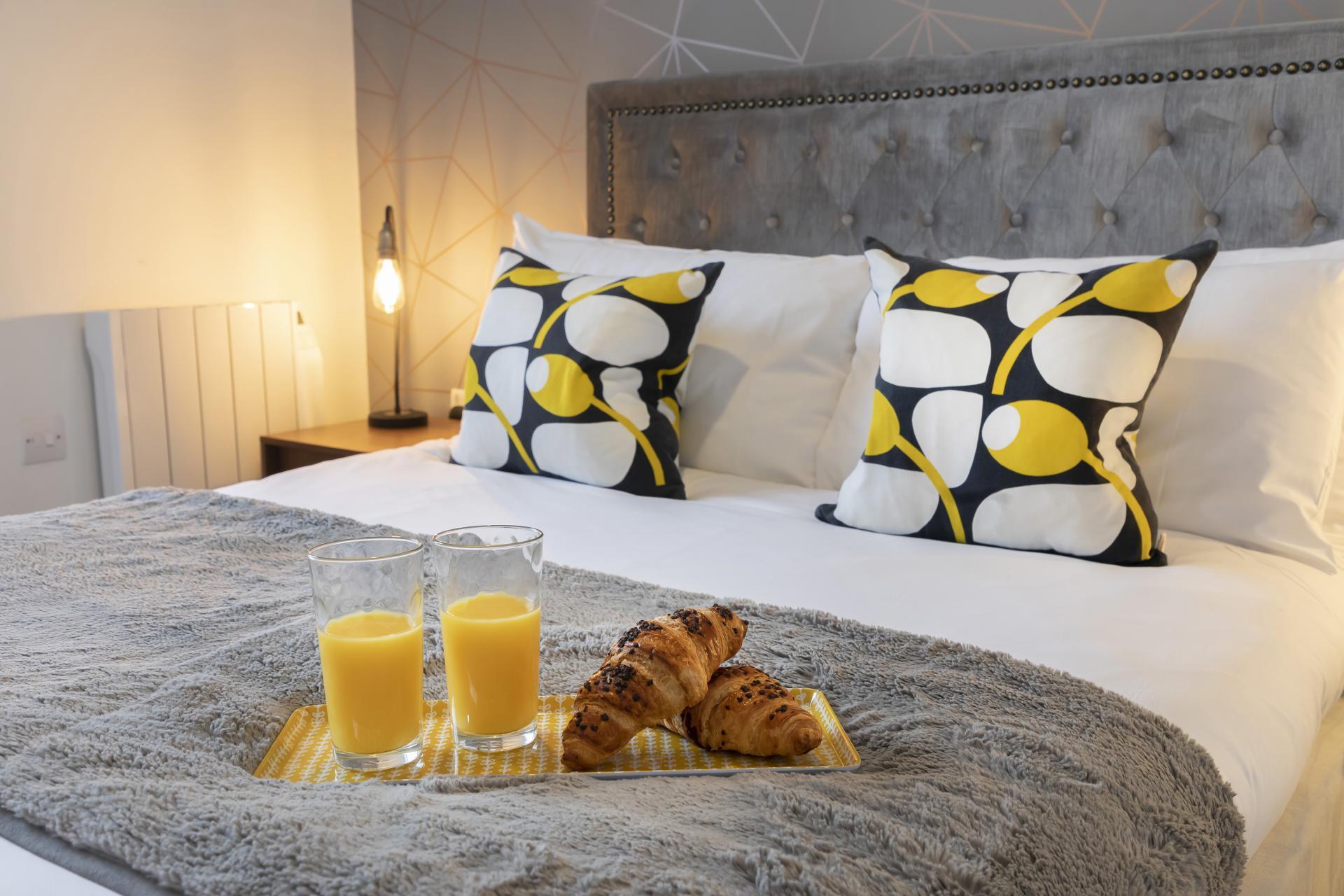 Comfy bed at Axiom No. 8 Apartment - Citybase Apartments