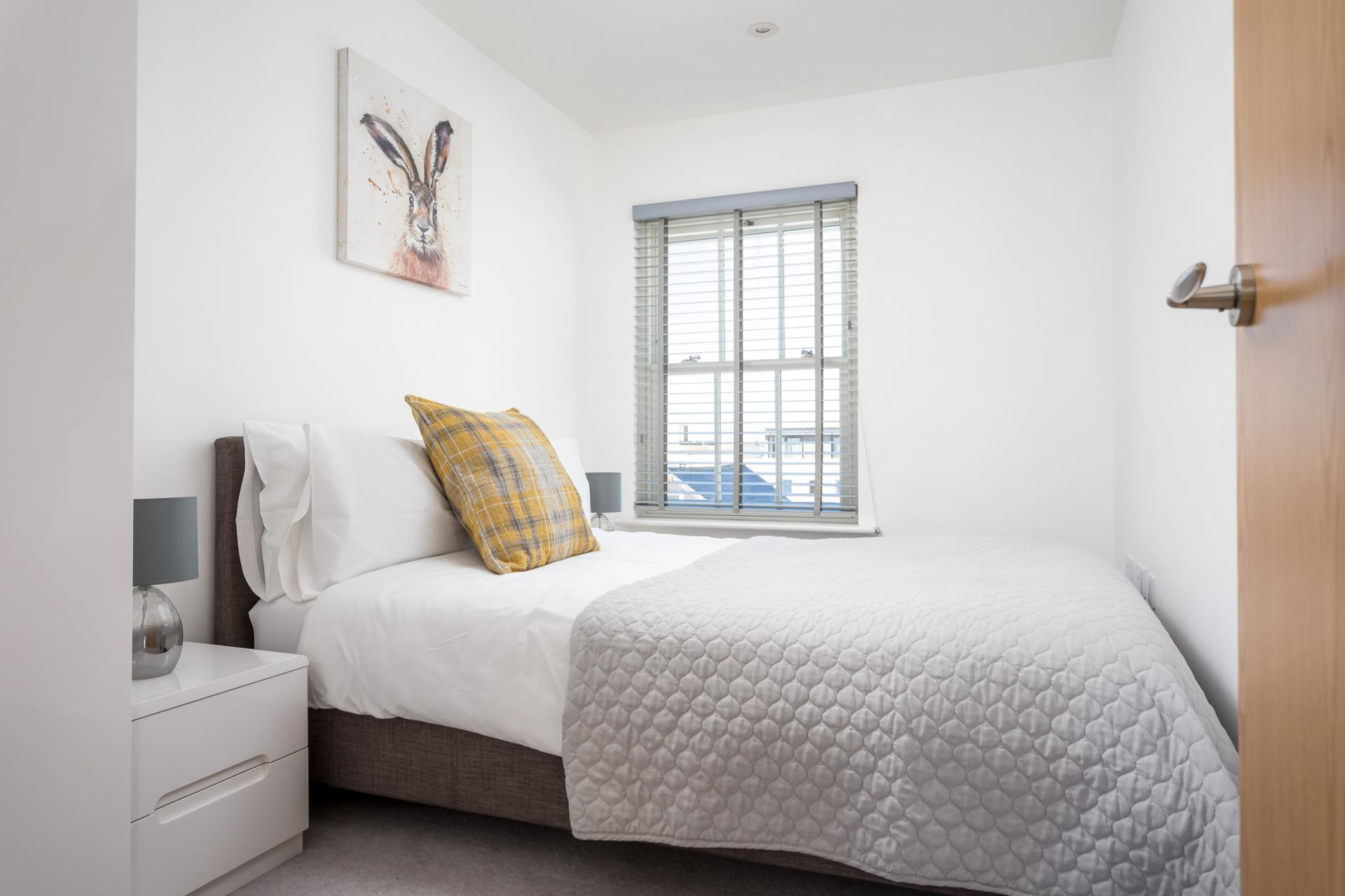Bed at Prince Regent Mews Apartment - Citybase Apartments