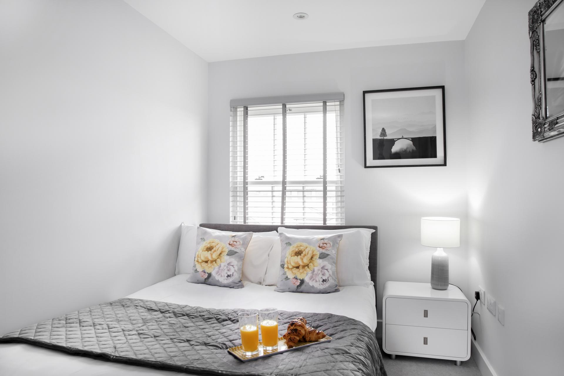 White bedding at Prince Regent Mews Apartment - Citybase Apartments