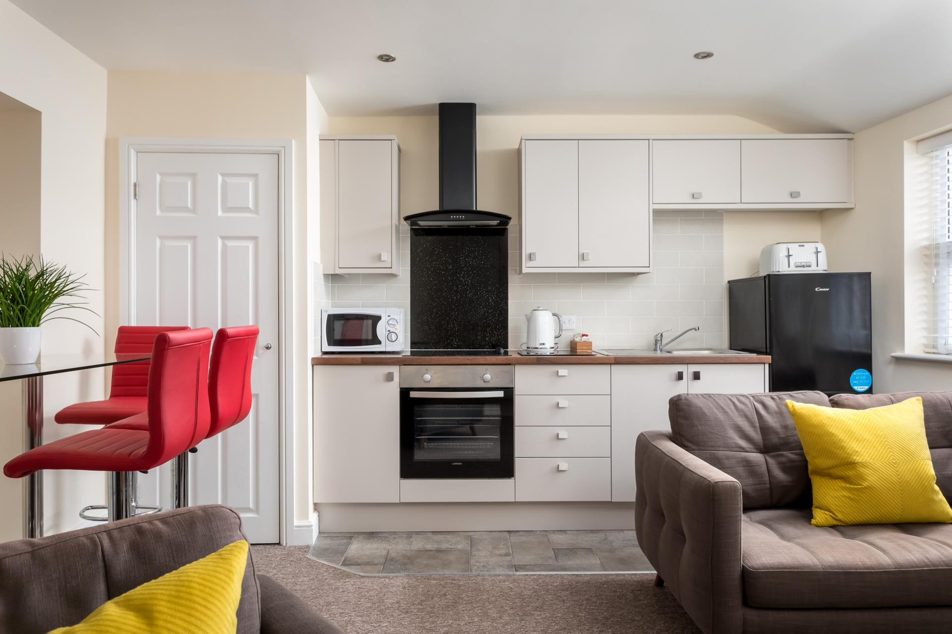 Open-plan living area at High Street Serviced Apartment - Citybase Apartments