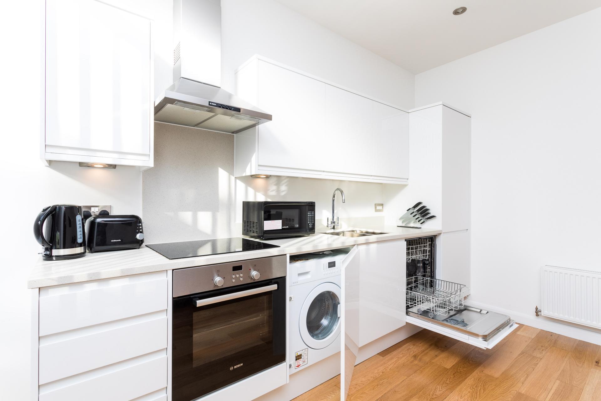 Kitchen at Emerald House Apartments - Citybase Apartments