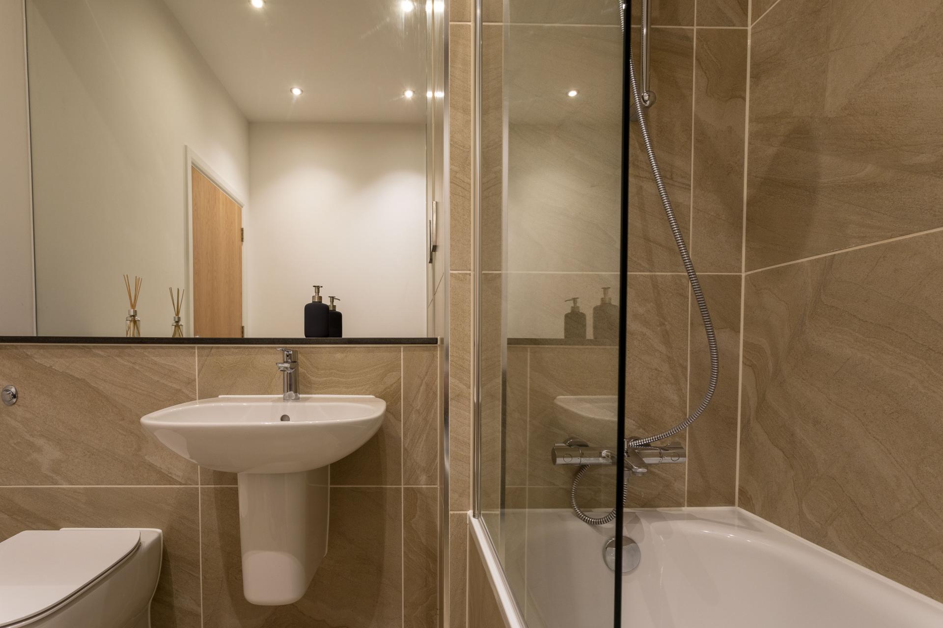 Bathroom at Emerald House Apartments - Citybase Apartments