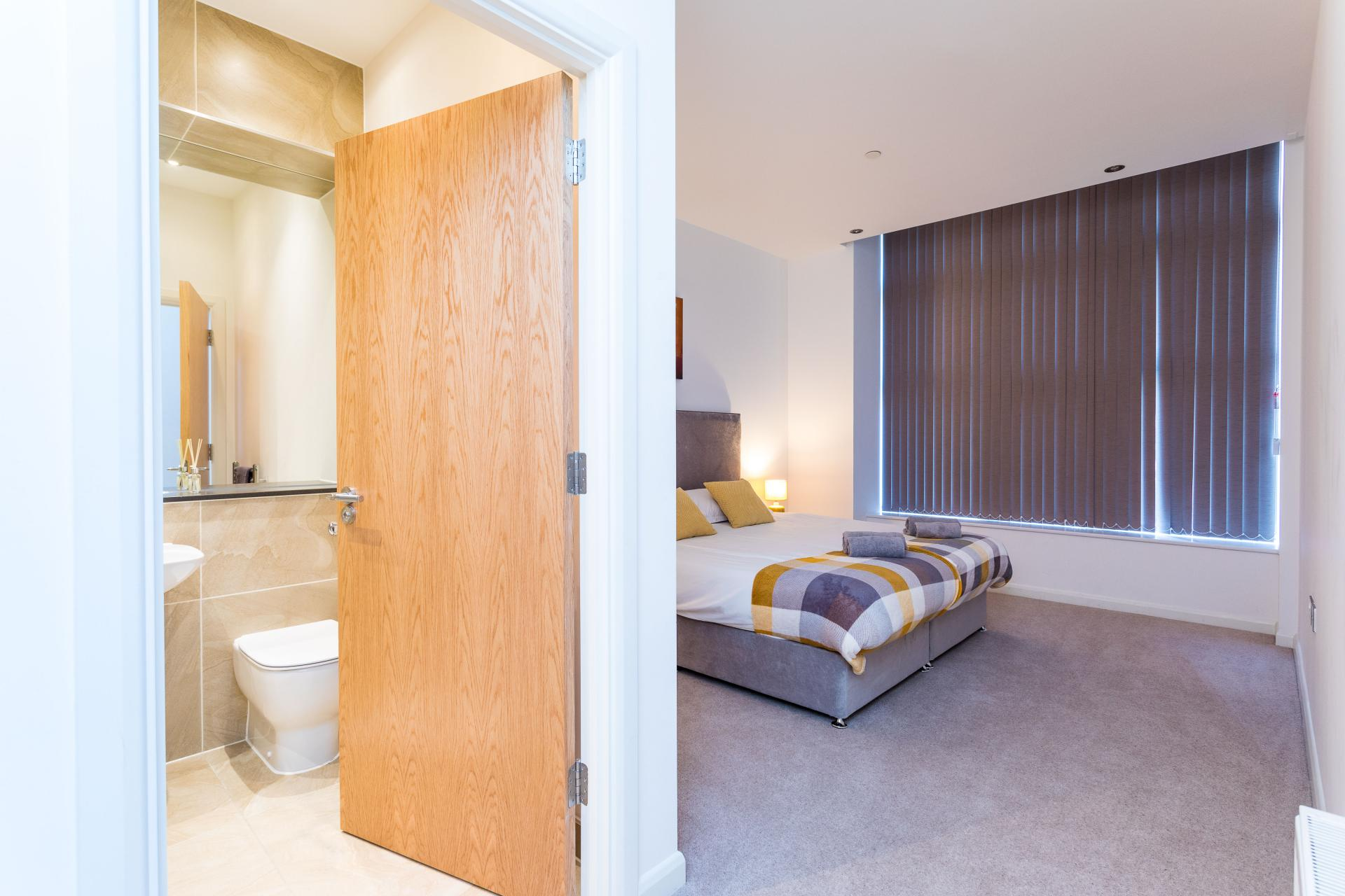 Spacious bedroom at Emerald House Apartments - Citybase Apartments