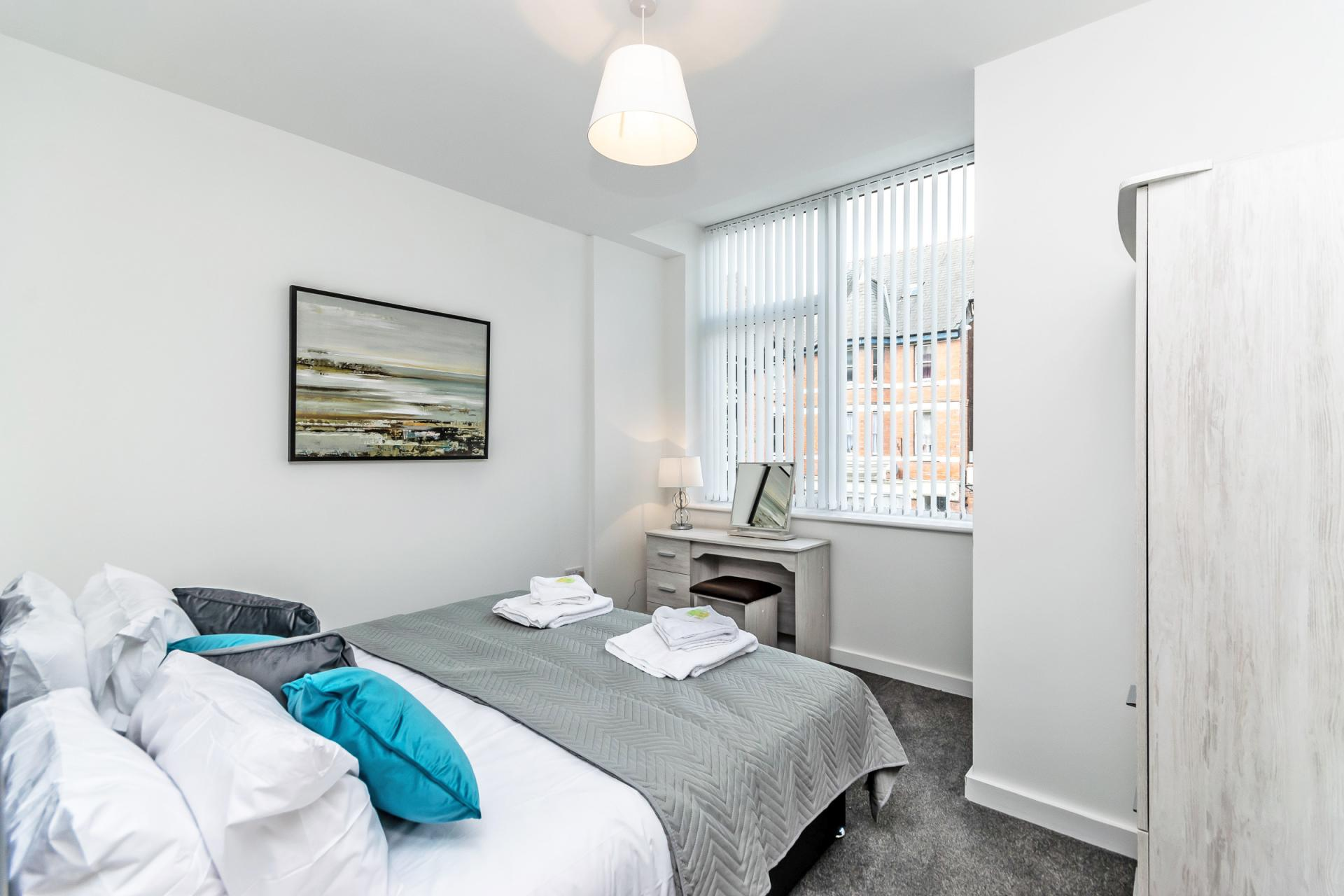 Comfortable bed at City Suites Apartments - Citybase Apartments