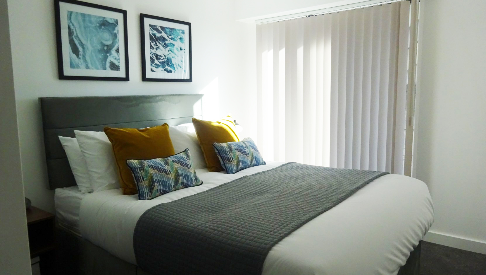 Stylish bedroom at The Forum Apartments - Citybase Apartments
