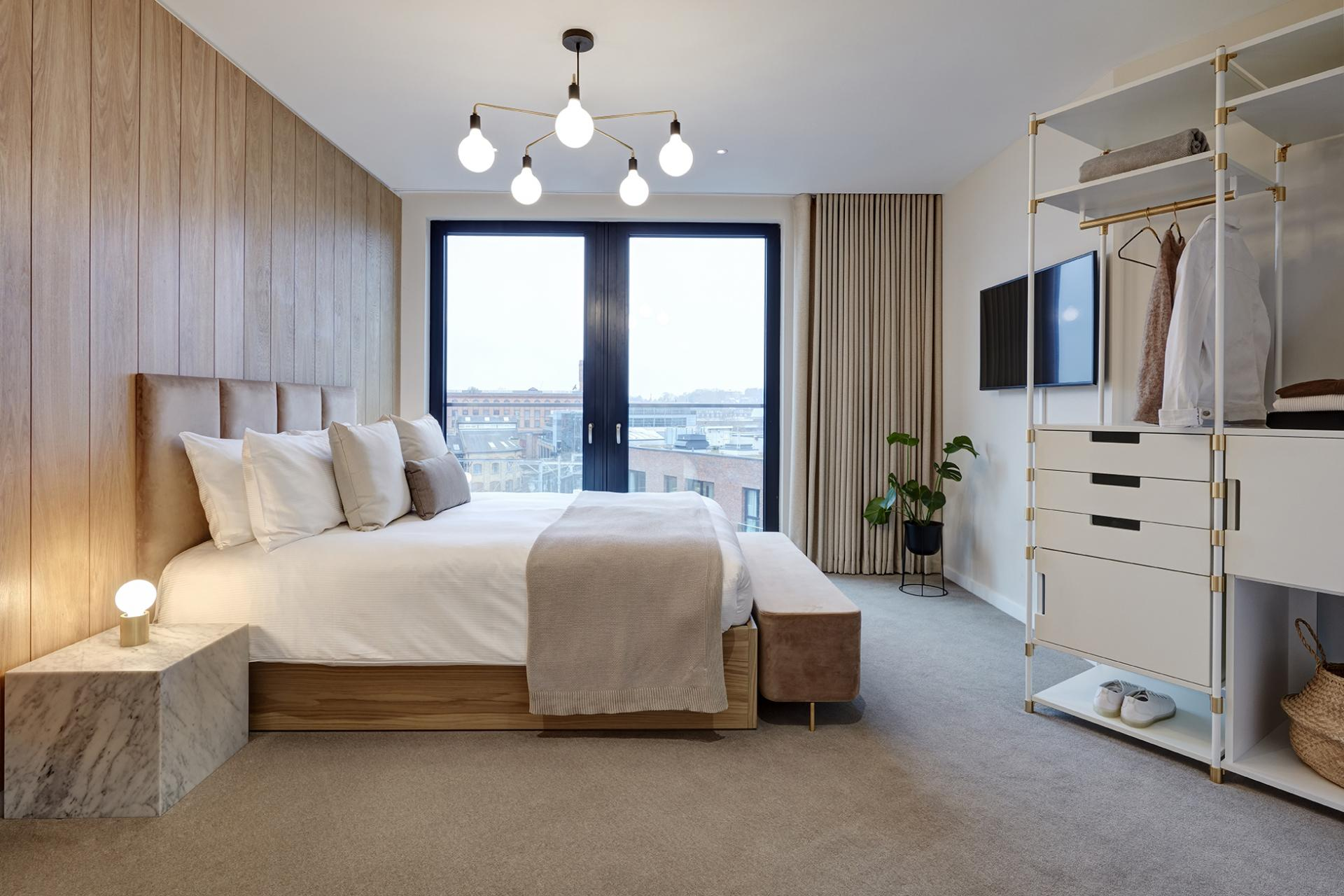 Master bedroom at STAY Camden Serviced Apartments, Camden, London - Citybase Apartments
