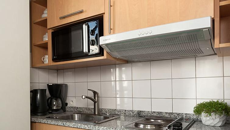 Convenient kitchen at Residence Du Roy Apartments - Citybase Apartments