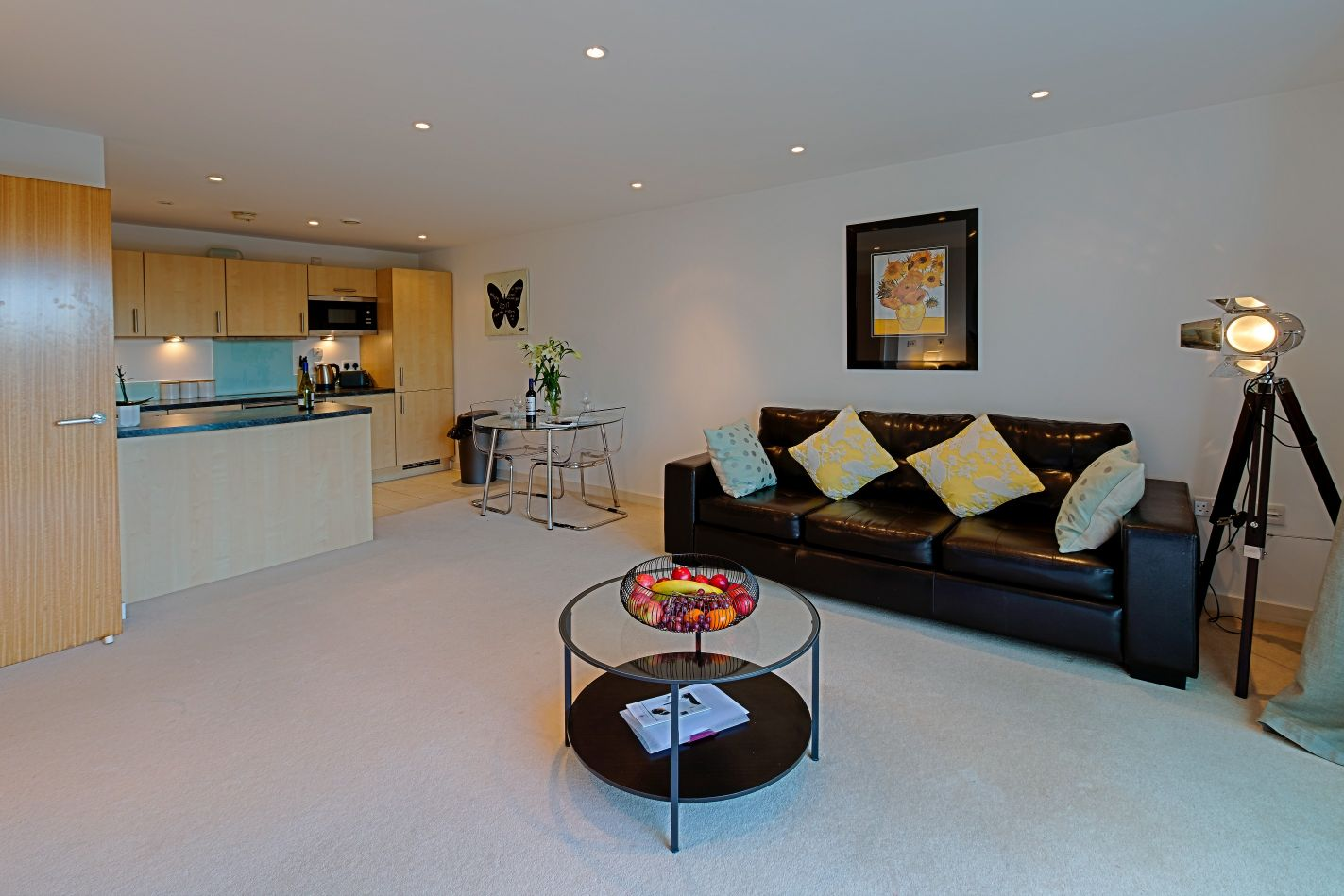 Open-plan living area at Gunwharf Quays Serviced Apartments - Citybase Apartments