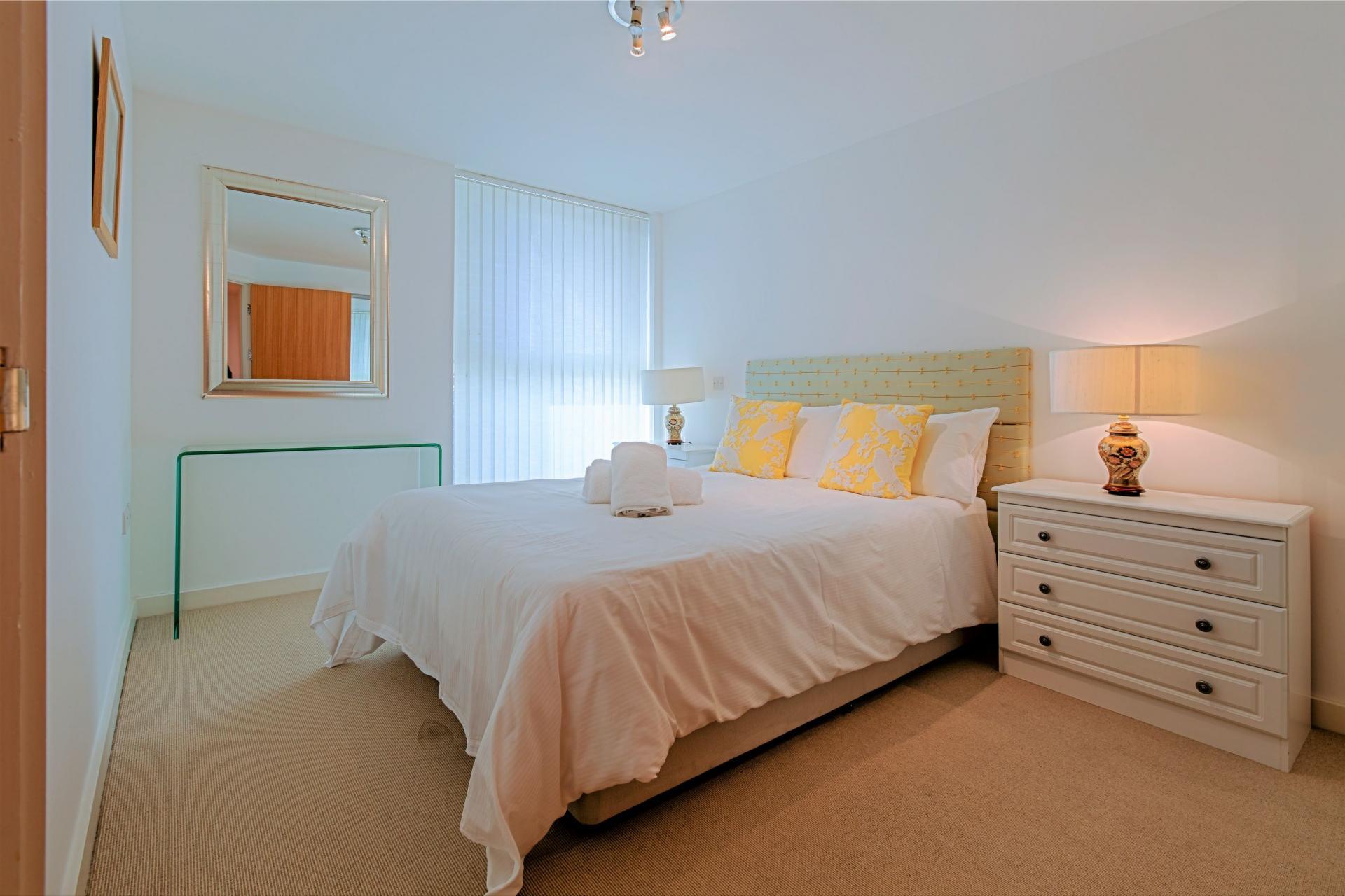 Stylish bedroom at Gunwharf Quays Serviced Apartments - Citybase Apartments