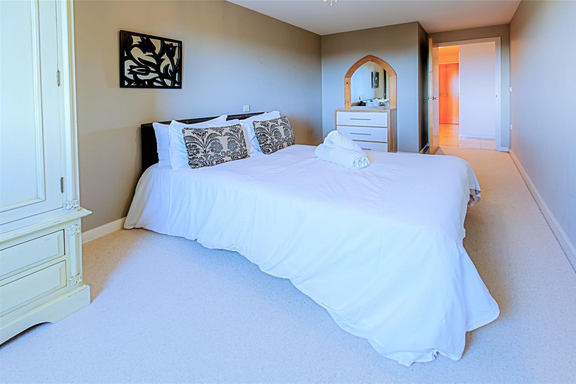 Bright bedroom at Gunwharf Quays Serviced Apartments - Citybase Apartments