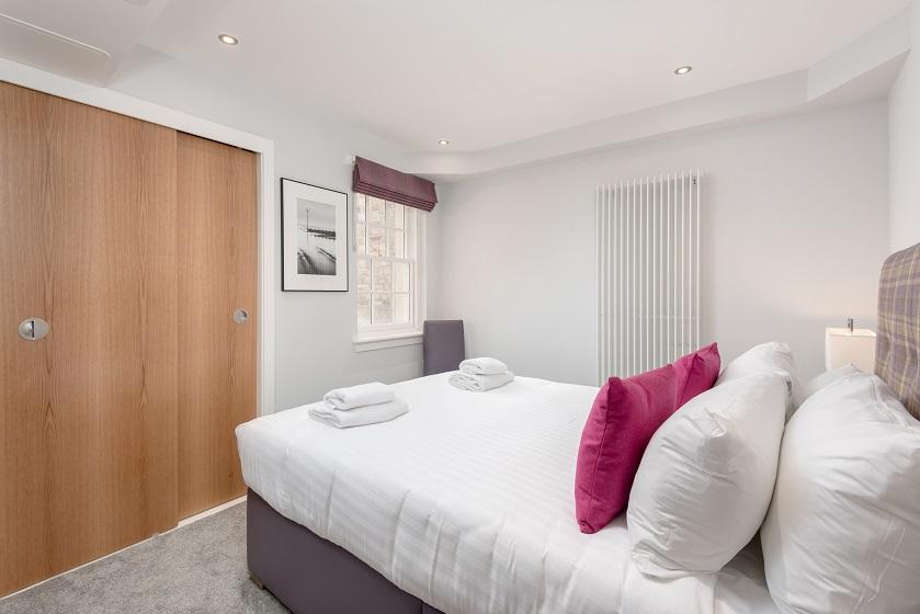 Stylish bedroom at Royal Mile Residence Apartments - Citybase Apartments